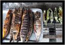 čerstvě grilované ryby na tržišti